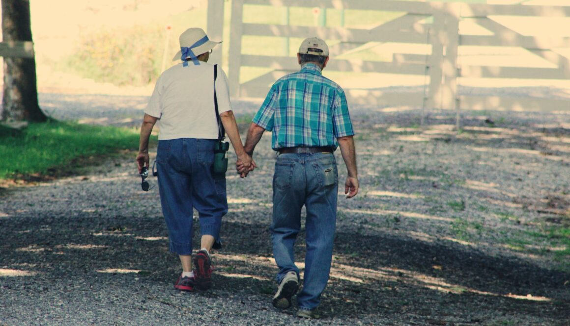 old-couple-walking-while-holding-hands-906111